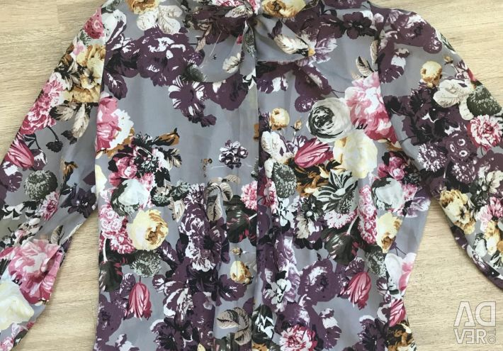 Blouse in a flower with a bow