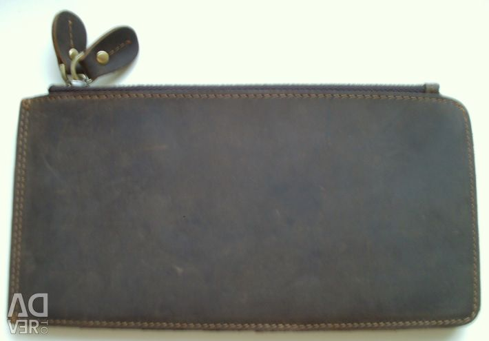 Brown leather wallet. Dimensions 20 * 10.5 * 2.5cm
