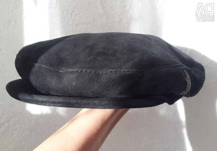 Men's cap from a natural sheepskin coat.