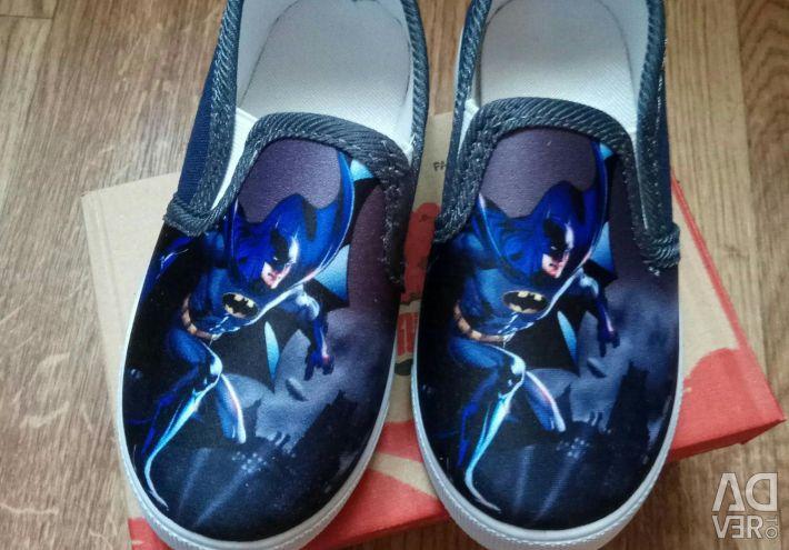 Bir erkek için spor ayakkabı.