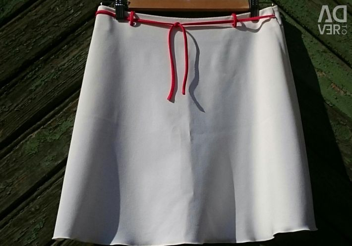 The skirt is white, female, sits very well