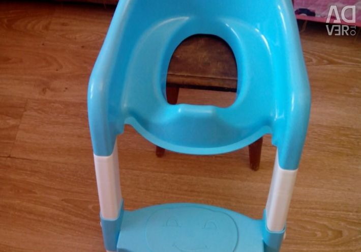 Baby seat on the toilet with a step.