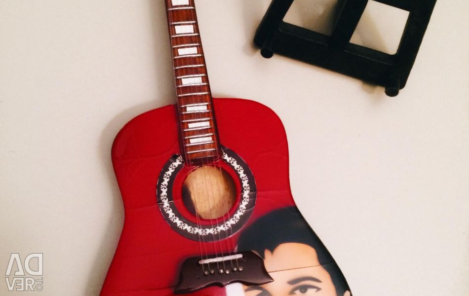 Decorative guitar on the stand