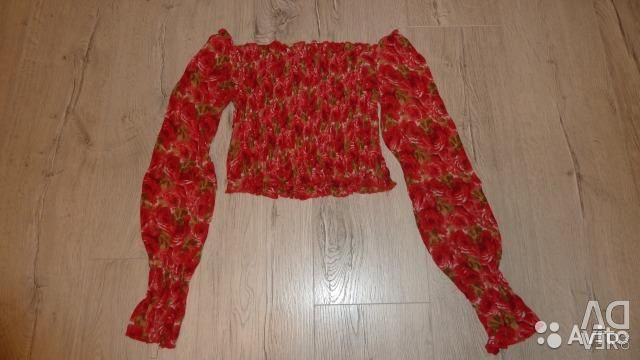 Bright blouse with floral print