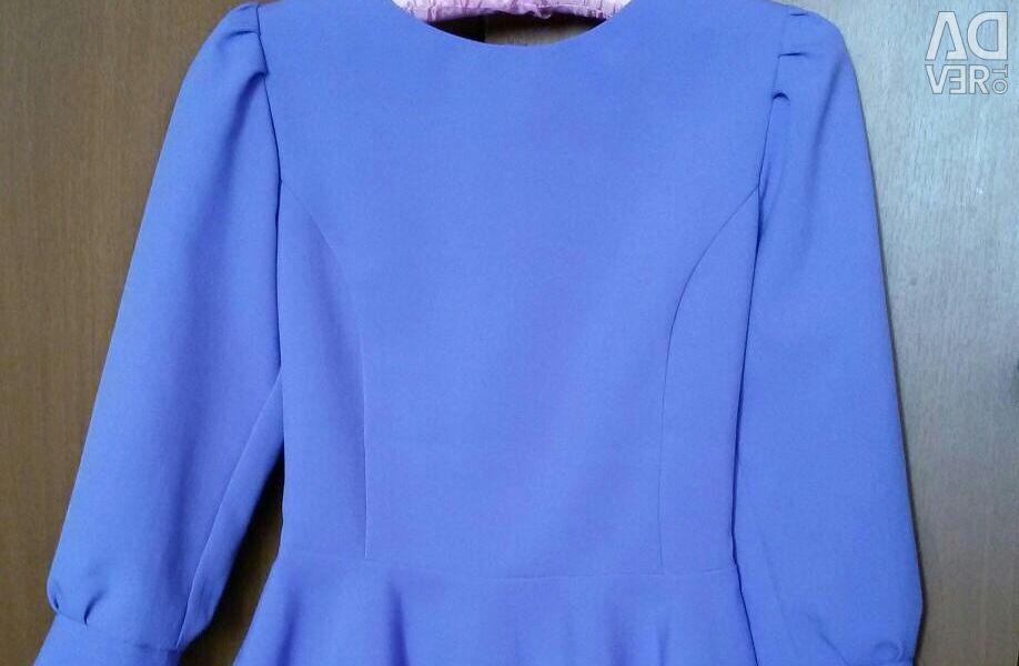 Bluză cu peplum.