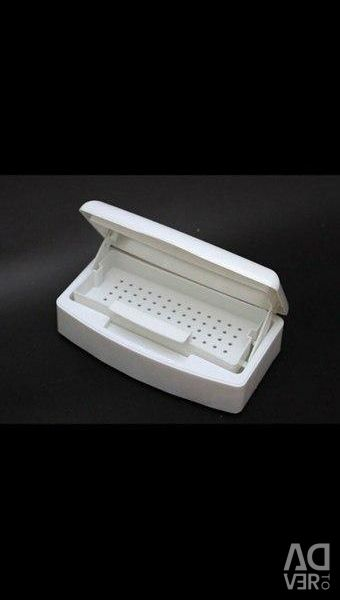 Container for sterilizing manicure tools.