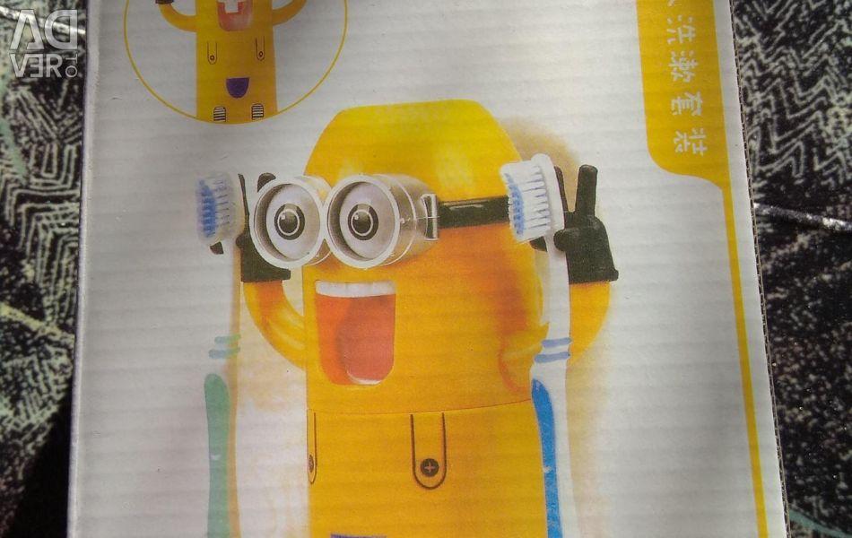 Minien toothpaste dispenser