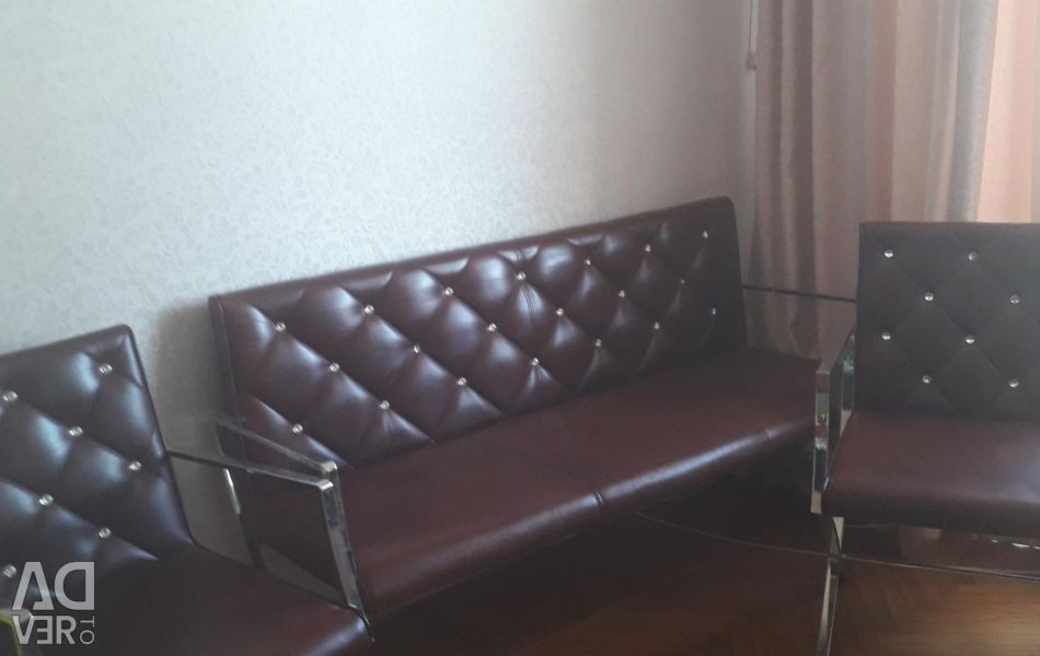 The sofa and chair are leather. with rhinestones